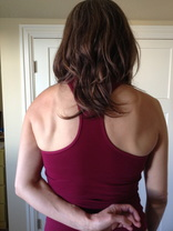Hand behind the back with shoulder blades wide