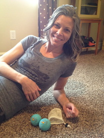 Using Yoga Tune Up balls to release tension between the shoulder blades